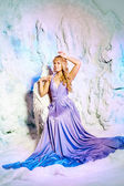 Young woman in princess dress on a background of a winter fairy  — Stock Photo