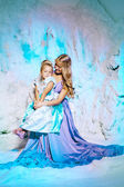 Little girl with mother in princess dress on a background of a w — Stock Photo