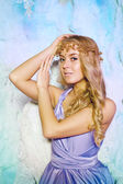 Young woman in princess dress on a background of a winter fairy  — Stockfoto