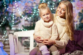 Winter mother and daughter. Smiling woman and child. Cute girl w — Stock Photo