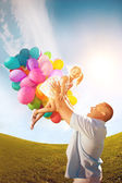 Father throws daughter. Familly playing together in park with ba — Stock Photo