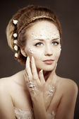 Woman with creative make-up of pearls. Beauty young girl with a  — Stock Photo