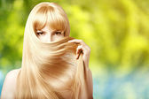 Beauty young woman with luxurious long blond hair. Girl with fre — Stok fotoğraf
