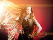 Woman with long hair. Beautiful young stylish fashionable girl w — Stock Photo