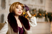 Beautiful adult woman in  winter coat with fur. Trendy modern bl — Stock Photo