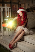 Young beautiful smiling santa woman. Christmas Fashionable luxur — Stock Photo