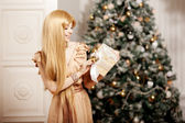 Luxury blonde in interior New Year. Young beauty trendy girl cel — Stok fotoğraf