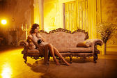 Luxury young woman in expensive interior. Girl with flawless mak — Stok fotoğraf