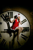 Luxury young woman in Santa costume on the big dial. Girl and cl — Stock Photo