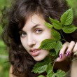 Girl with a green branch — Stock Photo #7489110