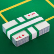 Deck of cards on poker table — Stock Photo