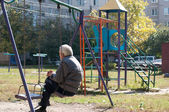 Old man swings — Stock Photo