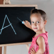 Girl writing on the board — Stock Photo