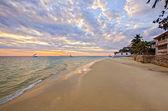 Sandy Beach with Boat and Sunset on Zanzibar — Stock Photo