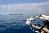 Old Boat sailing on toward the small island — Stock Photo