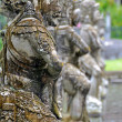 Row of stone sculptures at Tirtagangga Water Palace - Stock Photo