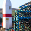 Crab nets closeup with Lighthouse in background — Stock Photo