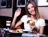 Corporate woman at a restaurant having a business lunch — Stock Photo