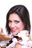 Beautiful girl holding orchid flower in her hands — Stock Photo