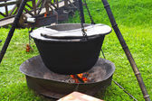 Cooking soup on the fire — Stock Photo
