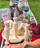 Items and souvenirs made of wood on the table — Stock Photo