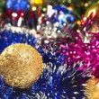 Golden Christmas ball and tinsel — Stock Photo
