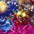 Blue and golden Christmas balls and tinsel - Stock Photo