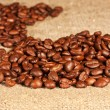 Coffee beans lying on sacking — Stock Photo