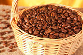 Coffee beans in a wicker basket — Stock Photo