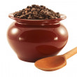 Coffee beans in a pot with a wooden spoon — Stock Photo