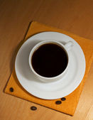 One coffee cup and saucer on a napkin — Stock Photo