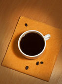 One white coffee cup on a napkin — Stock Photo
