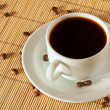 Stock Photo: One white coffee cup and saucer on table