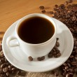 Stock Photo: Cup of coffee on wooden table top view
