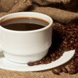Stock Photo: White cup of coffee with burlap sack