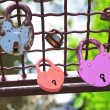 Red and pink heart-shaped padlocks — Stock Photo