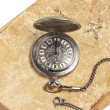 Pocket watch on ancient book — Stock Photo
