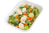 Fresh vegetables in a plastic container — Stock Photo