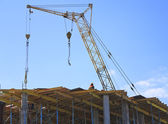 Crane working on the construction of the building — Stock Photo