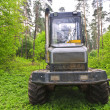 Large skidder in the woods — Stock Photo #26264493