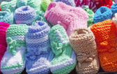 A miniature knitted shoes for kids — Stock Photo
