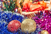 Red and Golden Christmas balls and tinsel — Stock Photo