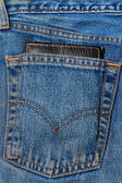 Wallet in the back pocket of jeans — Stock Photo