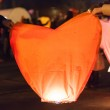 Man and woman holding a Chinese lantern — Stock Photo #40133615