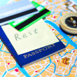 Passport, credit cards and compass on a map — Stock Photo #44368267
