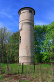Brick water tower in the forest — Stock Photo
