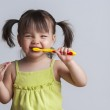 Girl brushing teeth — Stock Photo