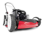 Red lawn mower — 图库照片