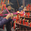 Burning incense upon the incense altar in temple — Stockfoto