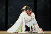 Chinese Sichuan opera performer make a show on stage with traditional costume. — Stock Photo